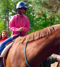Julia doesn't seem to have any fear on a horse.
