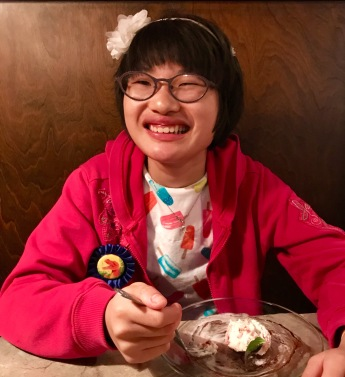 Dessert at 2nd Street Bistro in Ashland. Tiny cheese cakes with black raspberry laced ice cream. The smile says it all.
